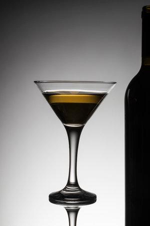 close-up studio shot glass wine glass silhouette alcohol bottle Foto de archivo