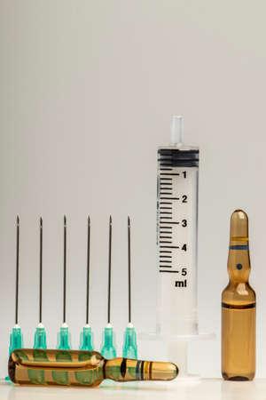 close-up studio medical equipment medicine bottle ampoule needle injector