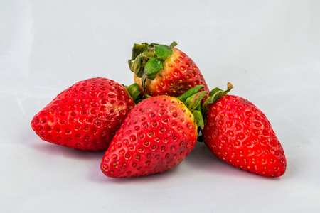 strawberies: Four strawberies isolated Stock Photo
