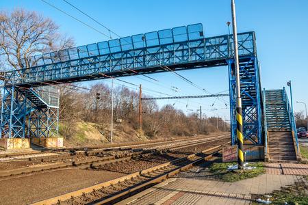 rapid steel: Blue footbridge over railroad, in Bratislava, Lamac, Slovakia