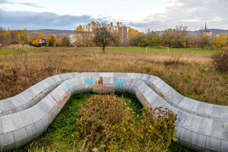prefab: Heating tubes outside of city, near football playground Stock Photo