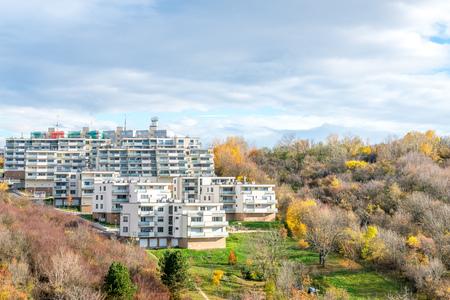 prefab: New block of prefab flats on hillside in forest Stock Photo
