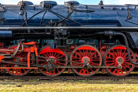 Side view on CSD, Czechoslovak steam locomotive, with huge, red spoke main wheels