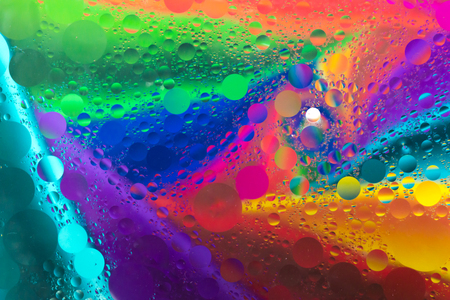 Rainbow background with oil spot bubbles on water surface with smoke pattern Stock Photo