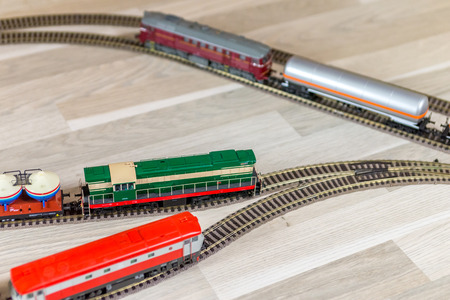 Three diesel model trains on wooden foor Stock Photo