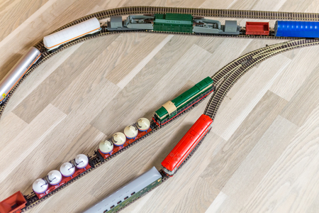 Aerial view on three model trains on wooden floor Stock Photo