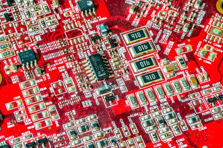 Red printed curcuit board PCB for computer components with electronic elements Stock Photo - 149323934