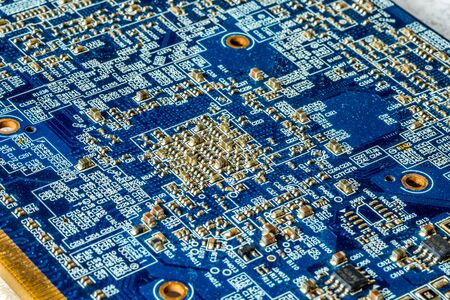 Blue printed curcuit board PCB for computer components with electronic elements Stock Photo - 149323323