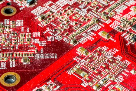 Red printed curcuit board PCB for computer components with electronic elements Stock Photo - 149323827