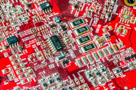 Red printed curcuit board PCB for computer components with electronic elements Stock Photo - 149330960