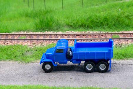 Blue scale truck on model train railroad layout road Stock Illustration - 149337830
