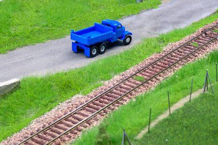 Blue scale truck on model train railroad layout road Stock Photo - 149337962