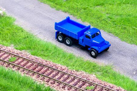 Blue scale truck on model train railroad layout road Stock Photo - 149338229