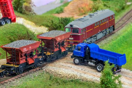 Model train cars loaded by coal with heavy truck, model scale H0