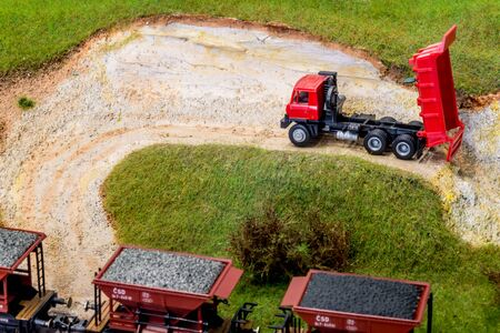 Model truck in scale H0 on train layout in stone pit Stock Illustration - 149337949