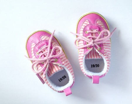15 18: Pink baby shoes