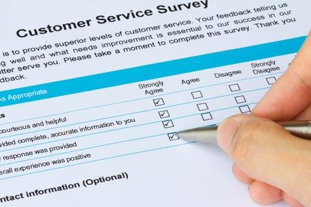fills: Very satisfy customer fills in customer service survey form
