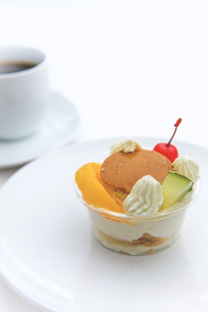 alamode: Pudding a la mode  and coffee on white background Stock Photo