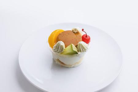 alamode: Pudding a la mode on white background Stock Photo