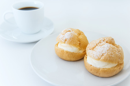 cream puff: Cream puff and coffee on white background