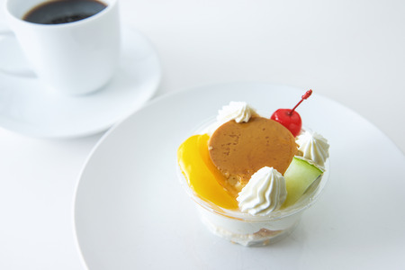 alamode: Pudding a la mode  and coffee on white background Stock Photo