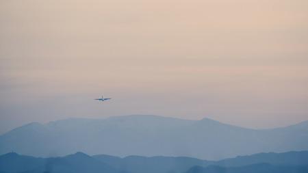 ridgeline: The passenger plane which flies in the nightfall sky