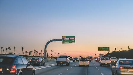 one lane street sign: Highway of nightfall in Los Angeles