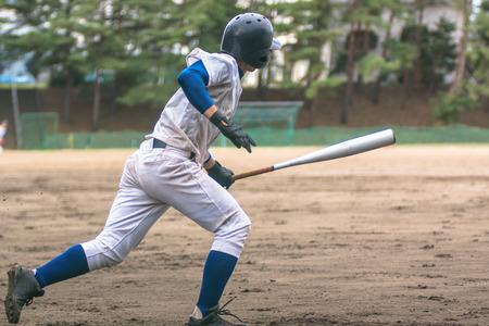 on high: El jugador de béisbol de alta escuela Foto de archivo