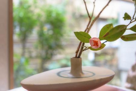Japanese flower arrangement of the pink camellia