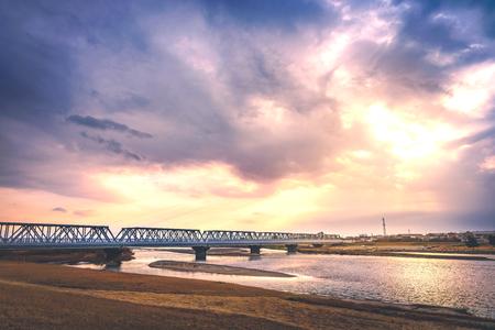 The iron bridge over the river in the nightfall