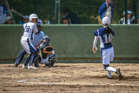 Game scenery of the girl student softball Stock Photo