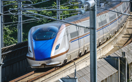 The E7 Series Shinkansen bullet train network of high-speed railway lines in Japan Редакционное