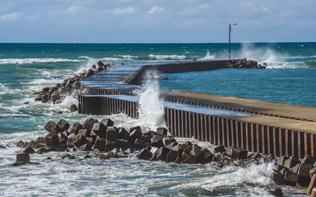 The waves beating the breakwater