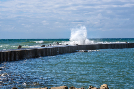 The waves beating the breakwater Stok Fotoğraf - 85366078