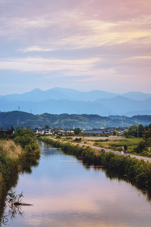Sunset scenery of the rice field and mount Hakusan