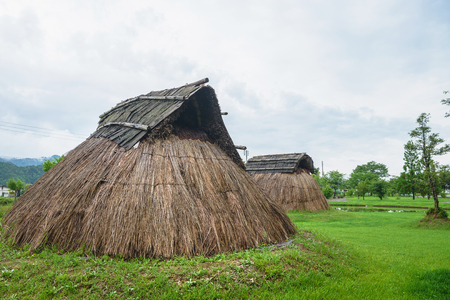 Pit dwelling houses Stock Photo