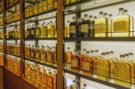 Unprocessed whisky in cabinet 写真素材