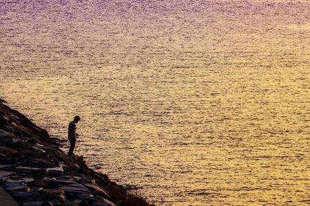 Beautiful sunset and angler