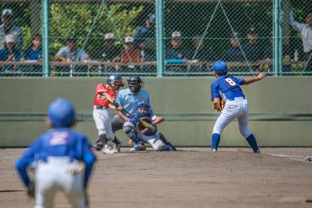 Little league baseball game 写真素材