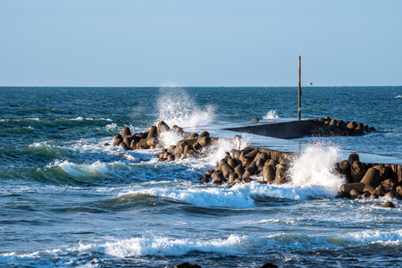 Waves beating the breakwater