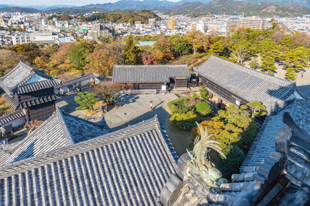 The main enclosure of Kochi-jo castle and Cityscape of the Kochi city in Japan