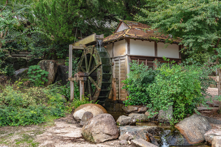 The water mill in the forest 写真素材