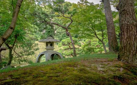 Stone lantern of the Japanese garden in Shukkeien Garden