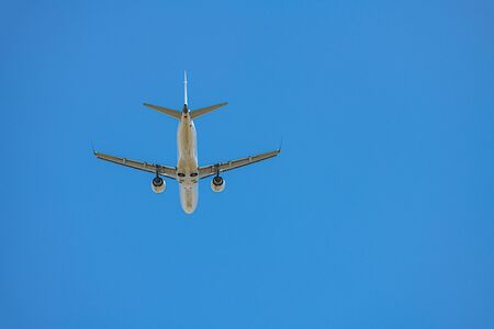 The passenger plane which flies in the blue sky Stock fotó
