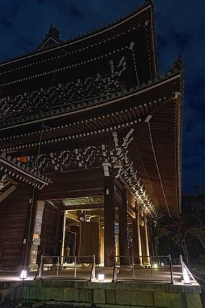 Buddhist temple gate at dark night in Kyoto, Japan