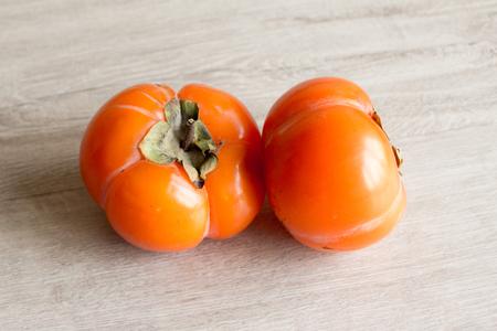 Fresh ripe persimmon, persimmon. Vitamins in the winter