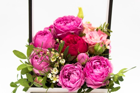 A bouquet of flowers in a gift box box, Booker of roses for mothers day. Roses in a gift box. Flowers on March 8. Happy womens day. Bouquet for a birthday.
