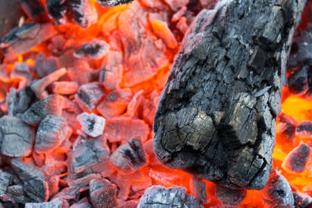 Smoldering charcoal in a barbecue close-up