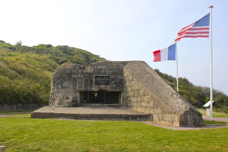 omaha: American and French Flags Over German Bunker, Omaha Beach Editorial