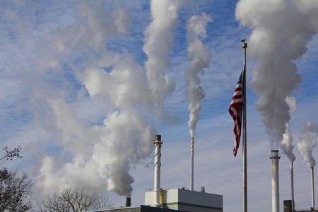 smokestacks: American Flag and Billowing Smokestacks Stock Photo